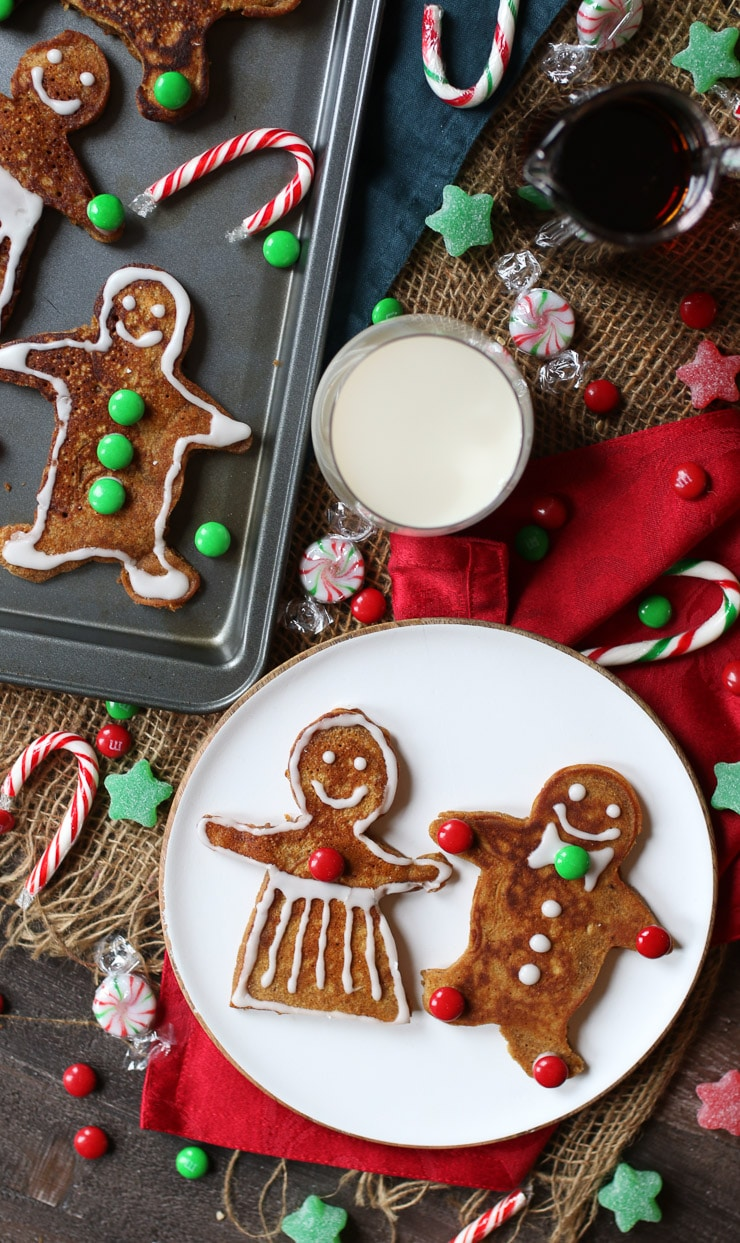 birds eye view of gingerbread holiday pancakes next to a glass of milk