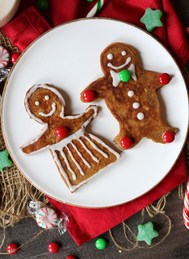 birds eye view of gingerbread man pancakes for the holidays on a white plate