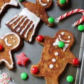 These Vegan Gluten Free Gingerbread Men Pancakes make the perfect Holiday breakfast recipe for decorating and enjoying with the kids.