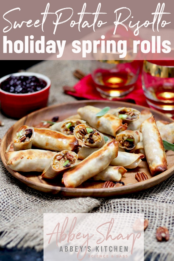 pinterest image of Baked sweet potato and risotto spring rolls on a platter next to a small red bowl containing dipping sauce with text overlay