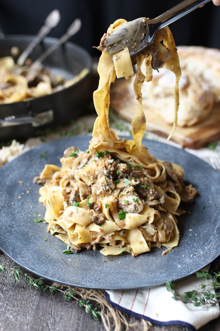 This Vegan Creamy Mushroom and Caramelized Onion Pasta is the perfect Healthy Holiday Dinner Recipe for entertaining your plant-based, vegetarian, vegan, and carnivore friends and family.
