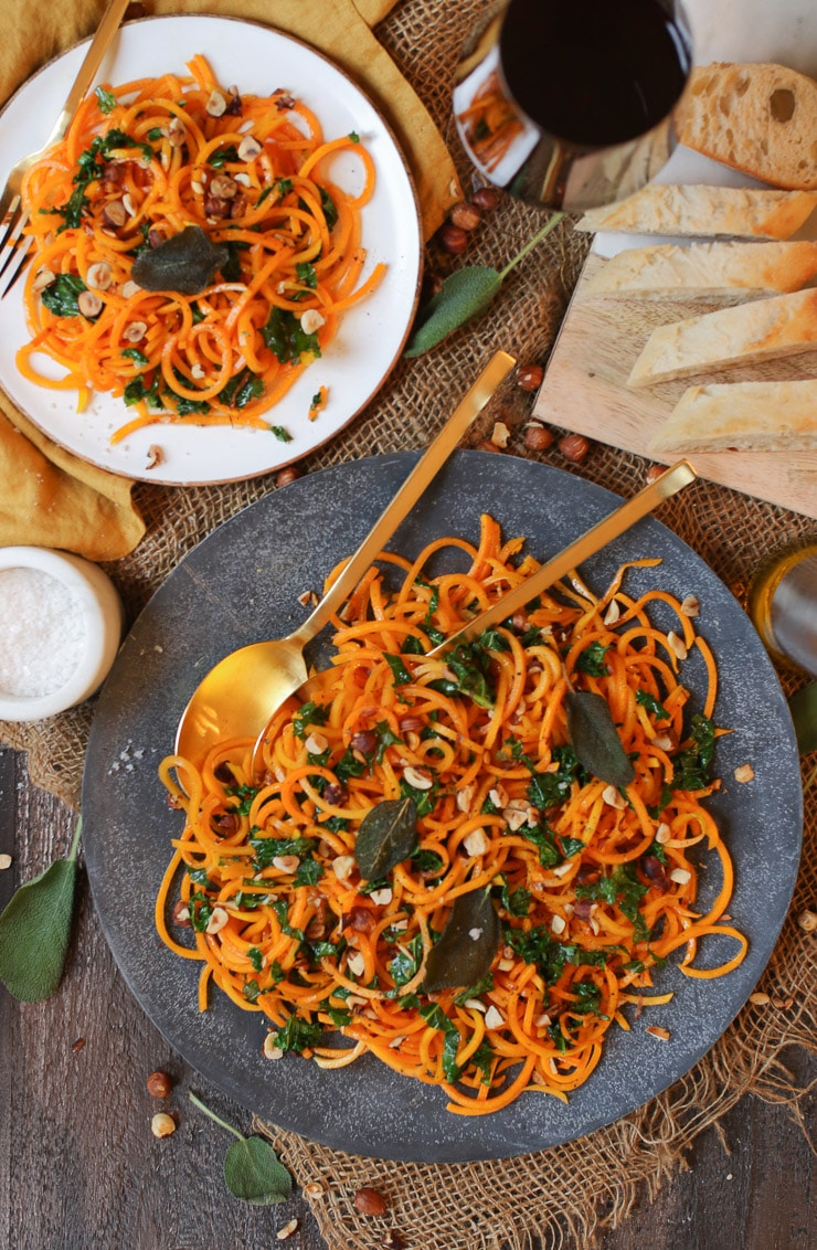 birds eye view of brown butternut squash noodles on a grey plate