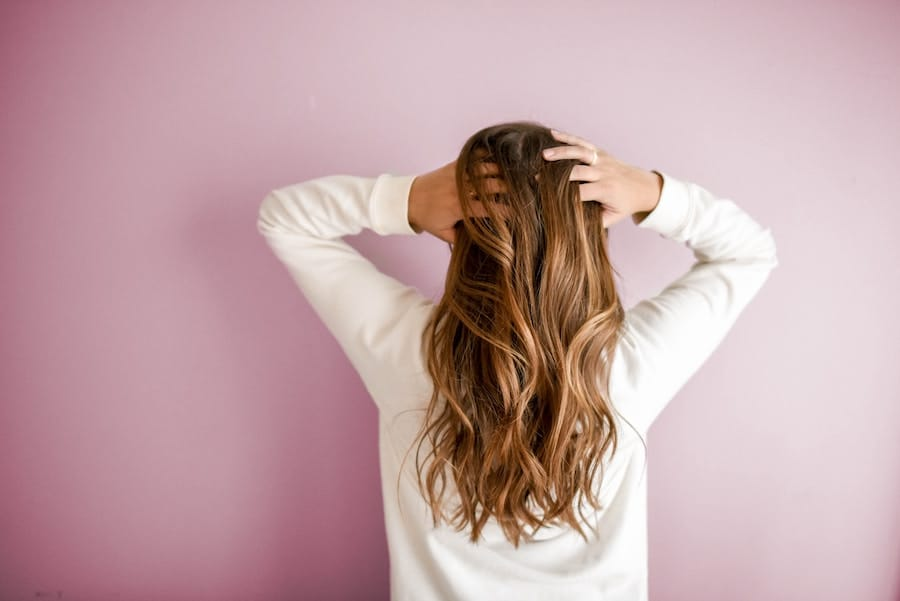 woman holding her hair from the back