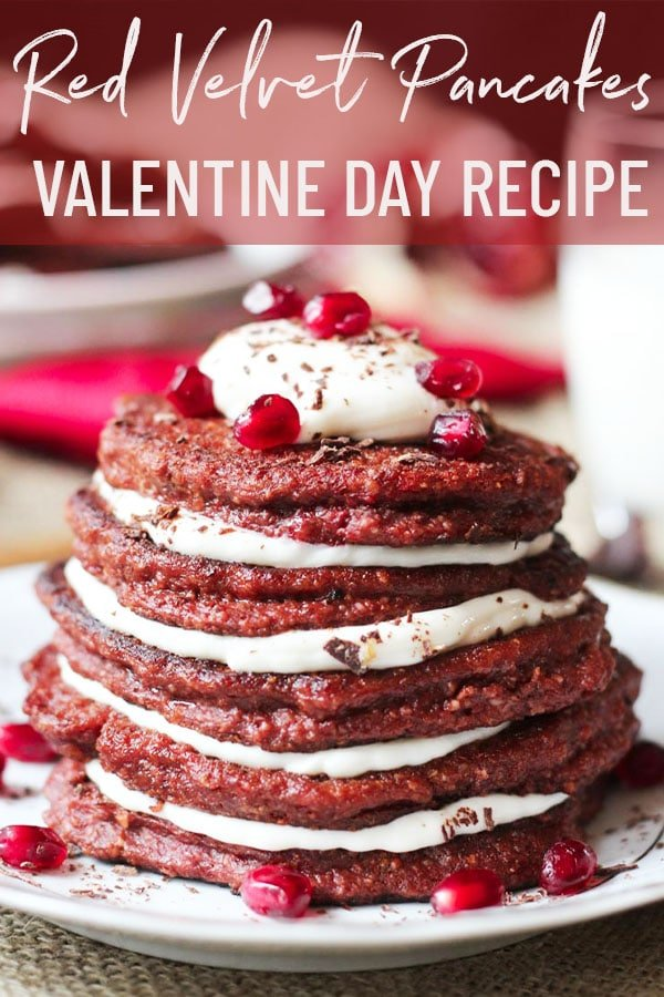 stack of red velvet pancakes topped with pomegranate seeds