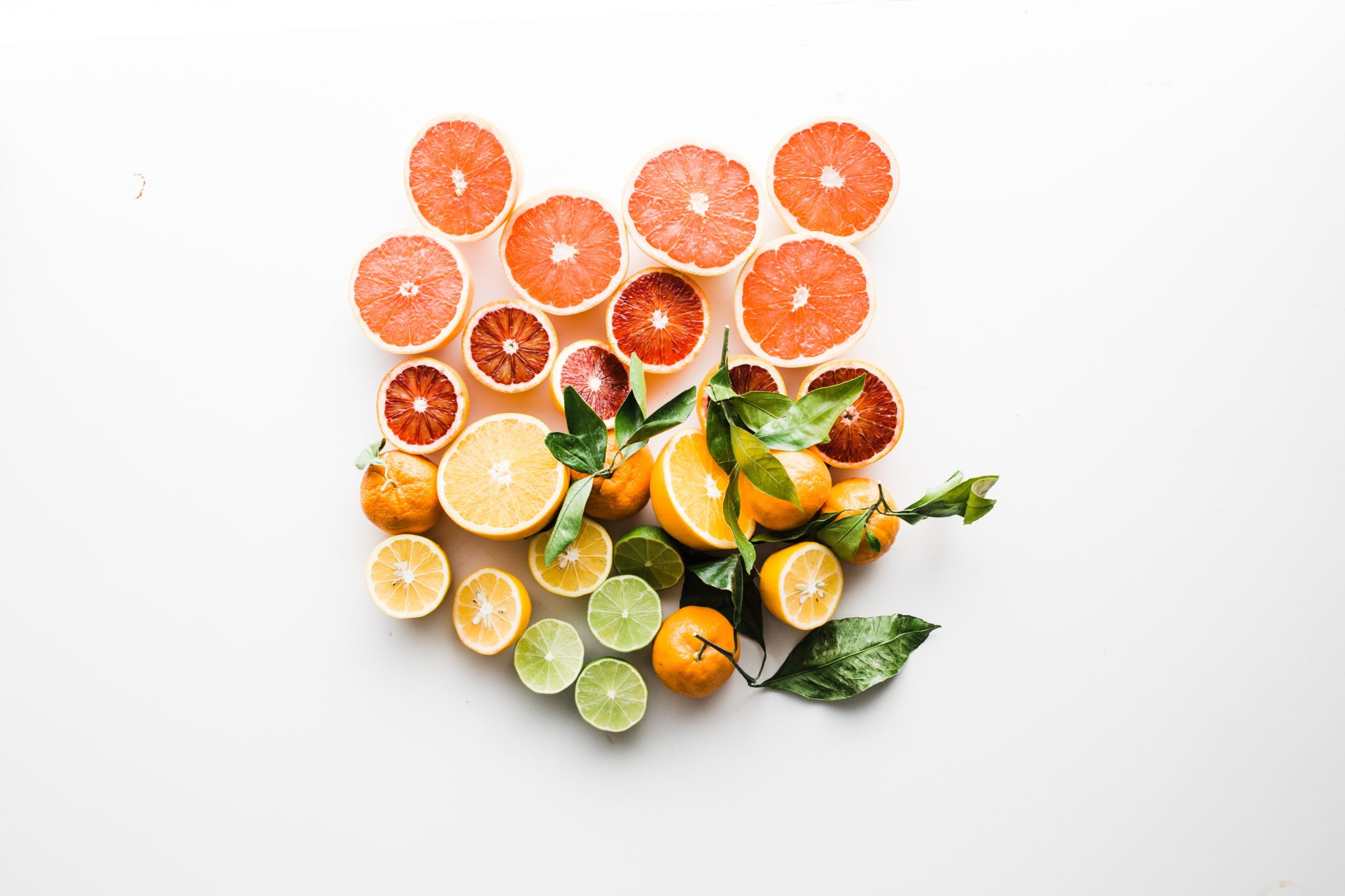 birds eye view of various fruits on a white background