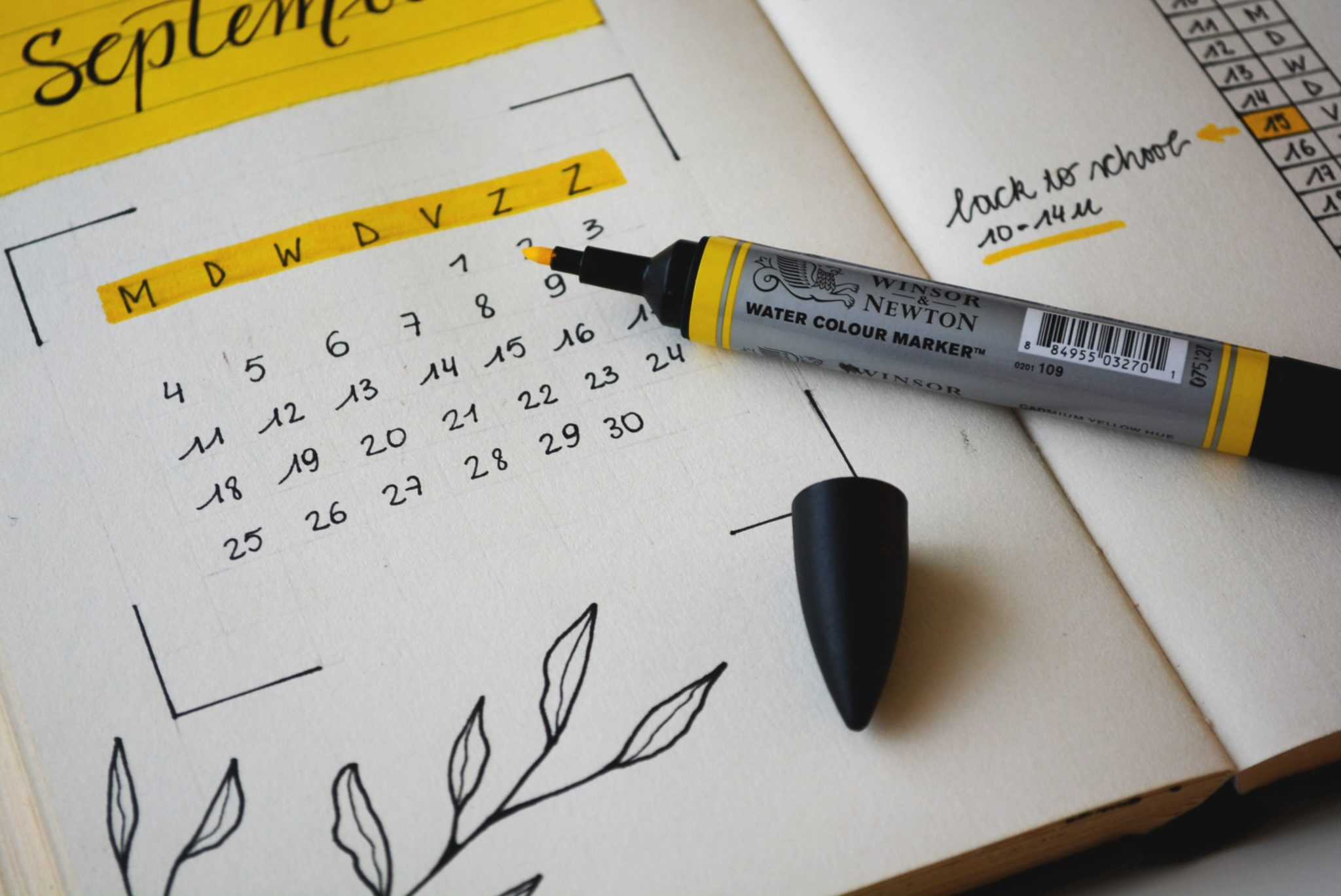 close up image of a calendar with a pen marking the days of a menstrual cycle