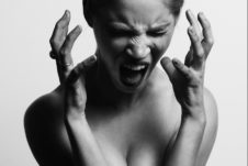 A woman screaming in black and white.
