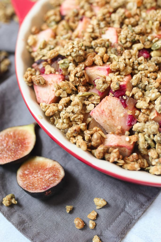 Close up of fruit crisp containing granola, apples and figs.