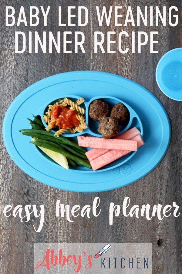 pinterest image of Baby led weaning dinner containing meatballs, pasta with tomato sauce, green beans and watermelon slices with text overlay