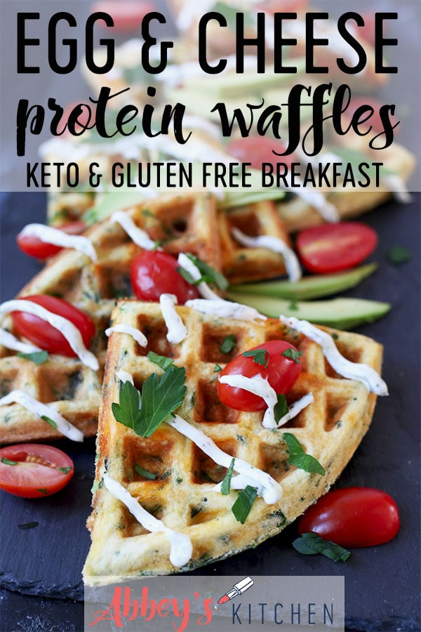 Egg and cheese savoury protein waffles topped with sliced avocados, cherry tomatoes, creamy drizzle and parsley.