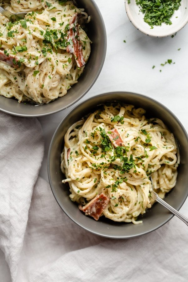 Two grey bowls filled with pasta carbonara from family meal plan.