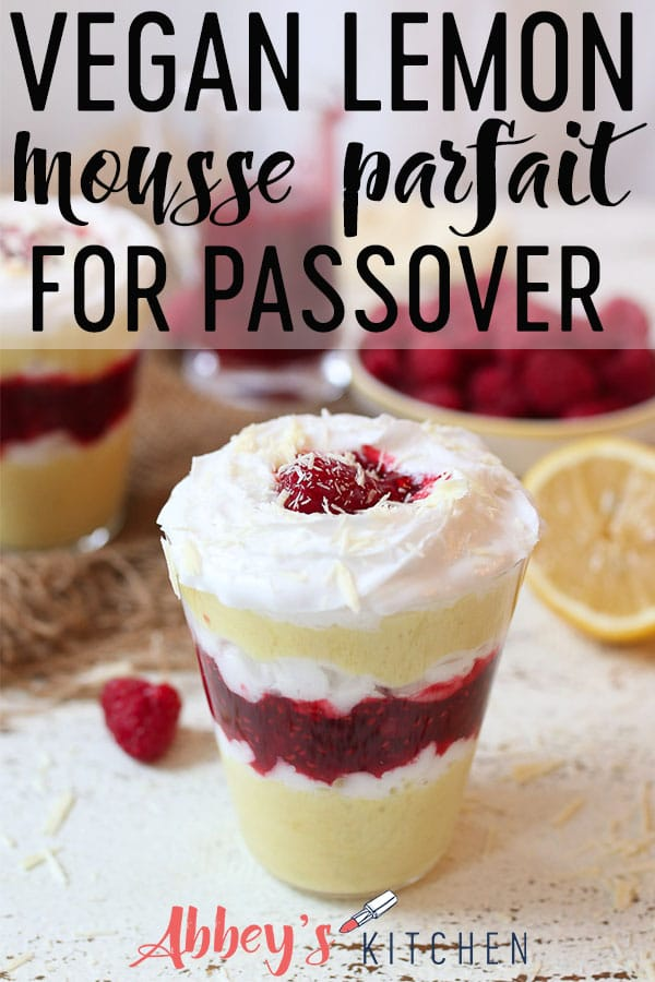 Vegan lemon mousse parfait layered with raspberry chia jam in a glass.