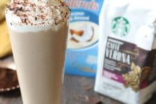 Tiramisu vegan milkshake in a tall glass with whip cream and a straw using Starbucks coffee and coconut milk.