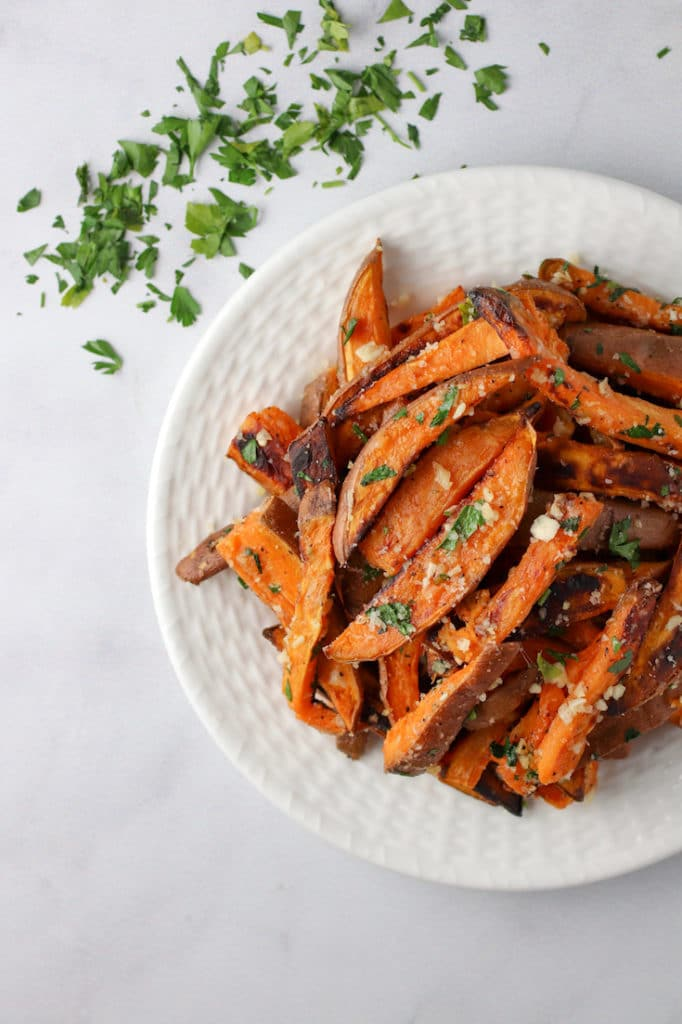 Sweet potato fries on a white plate from family meal plan.