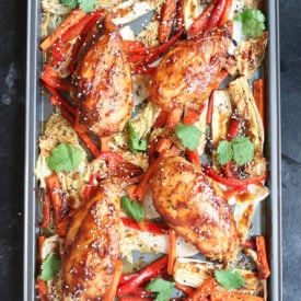 Four sticky chicken breast sheet pan dinner with cabbage and peppers.