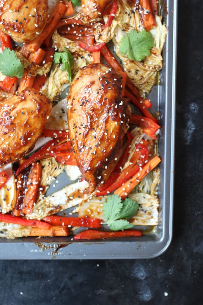 Sticky chicken breast sheet pan dinner with cabbage and peppers.