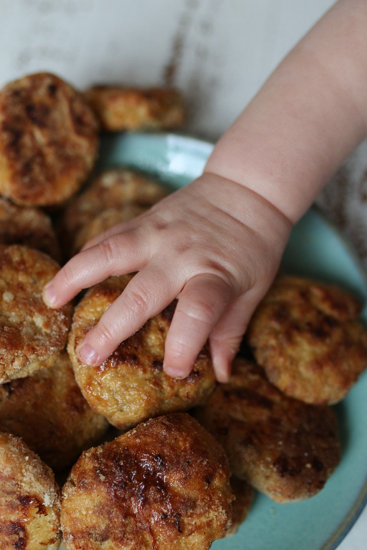Baby's hand holding better than McDonalds chicken nuggets.