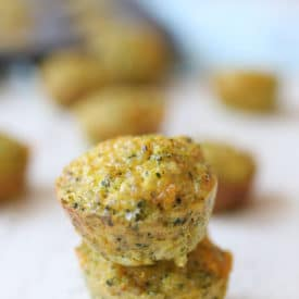 Two mini broccoli and cheese egg muffins piled on top of each other.