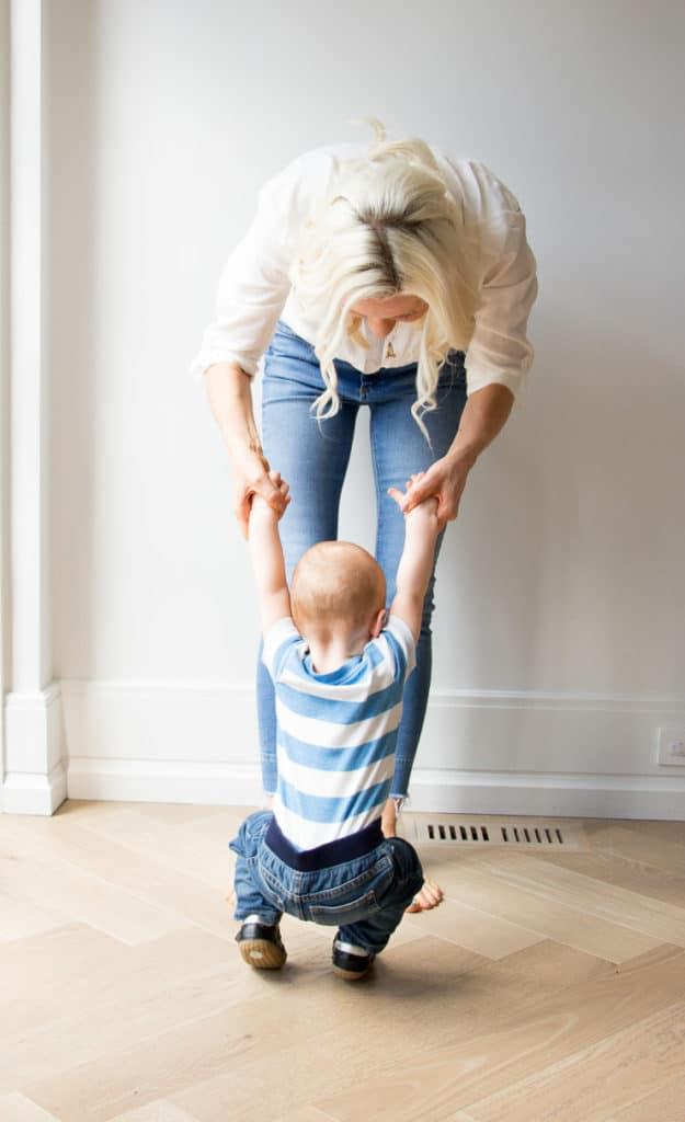 Women holding her baby boy.