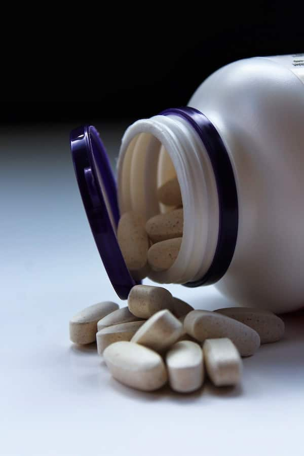 A pill bottle containing iron supplements.