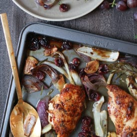Rosemary chicken on a sheet pan with roasted grapes and veggies.