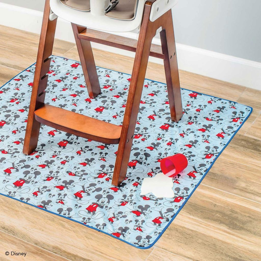 Splat mat underneath a baby high chair.