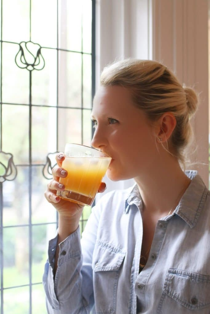 Women drinking a glass of a healthy hydrating low sugar drink.
