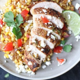 Mexican chicken and corn served on a plate.