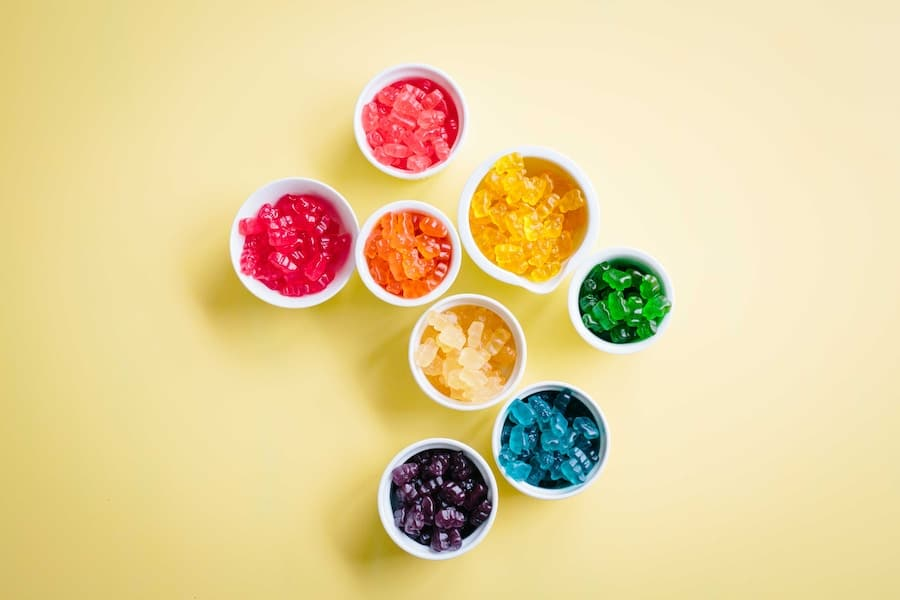 A bunch of bowls of different coloured gummy candies.