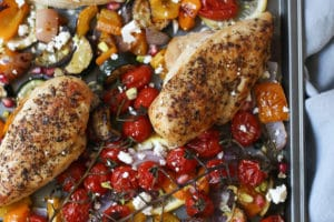 Greek chicken on a sheet pan with roasted veggies