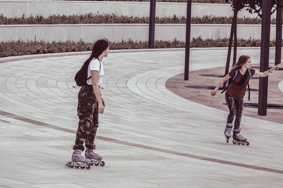 Two women rollerblading.