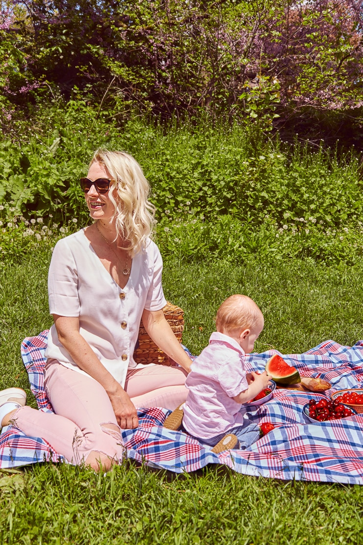 Women and her baby at a picnic outside.