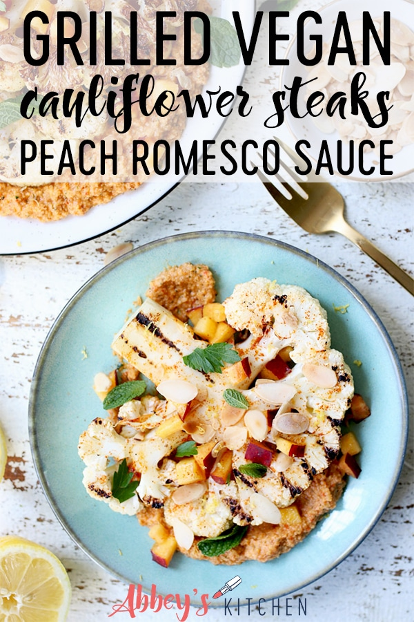 pinterest image of cauliflower steak topped with peach romesco sauce with text overlay