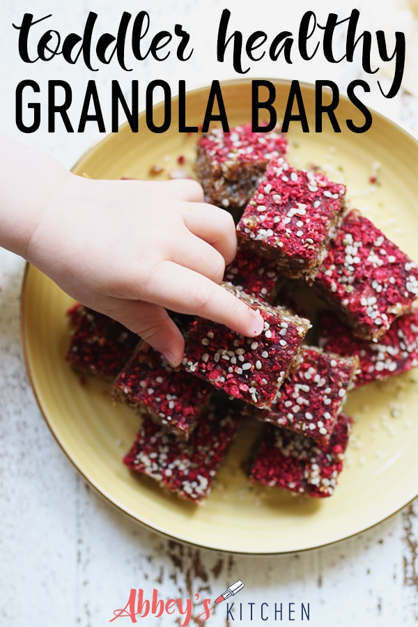 Baby hand reaching for granola bar.