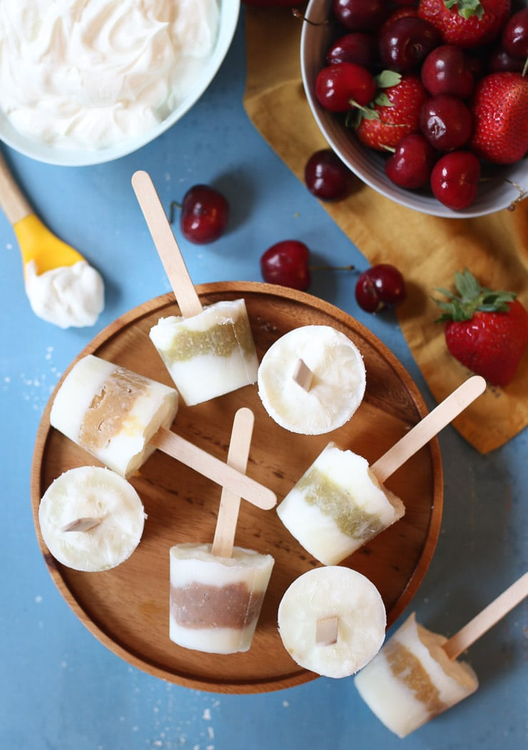 Baby popsicles on a wooden plate