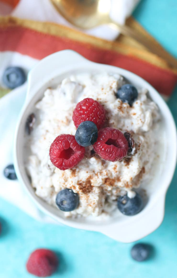 Rice pudding using yogurt topped with berries