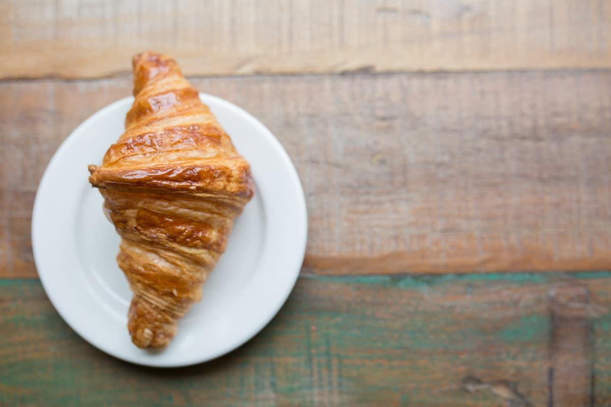 Croissant on a white plate