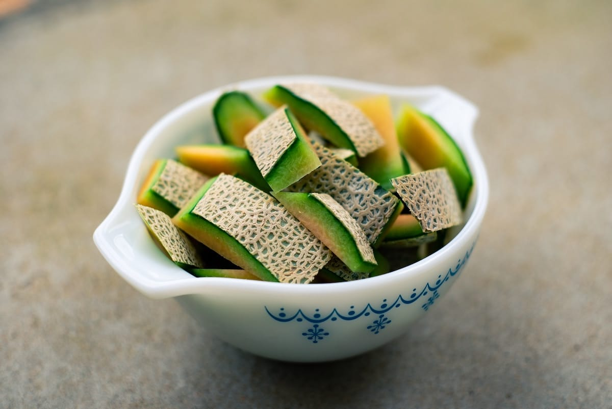 Bowl of sliced melon.