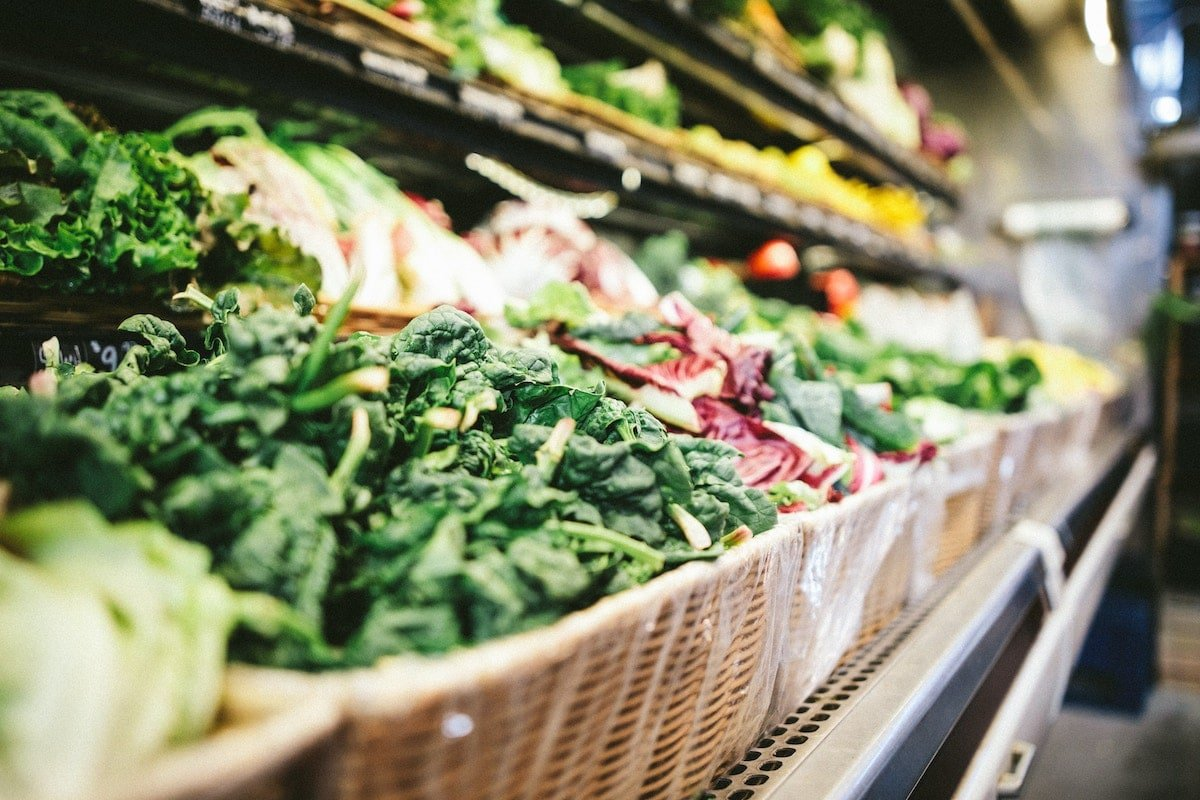 Selection of greens at a grocery store.