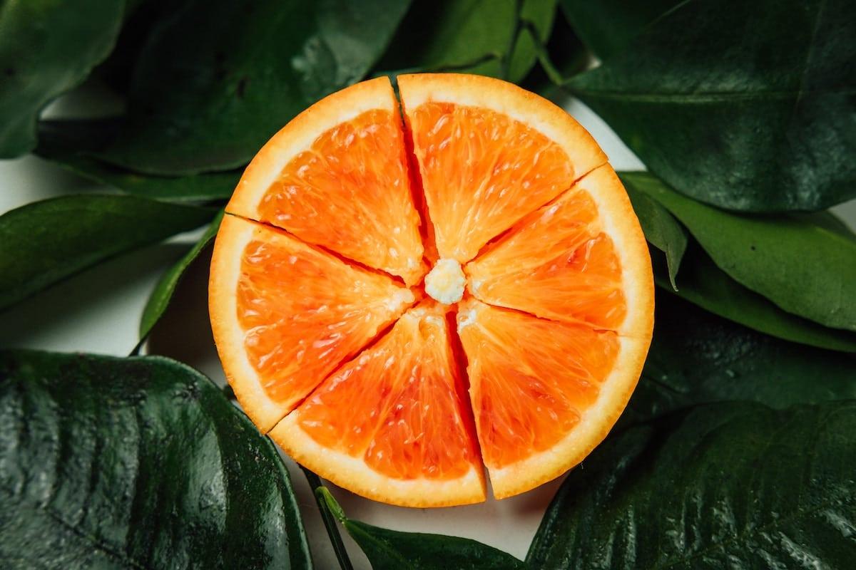 Half an orange cut into segments
