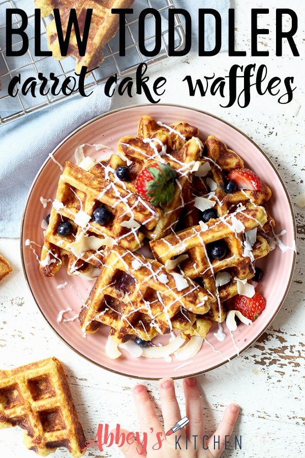 pinterest image of Carrot cake waffles topped with berries on pink plate with text overlay