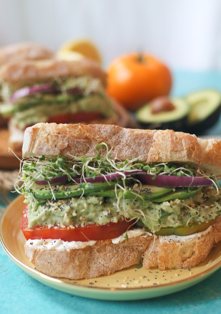 vegan sandwich on a yellow plate.