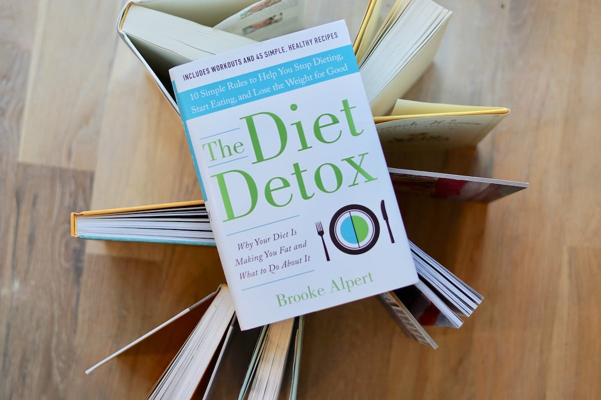 Birds eye view of a diet detox book on a wooden surface