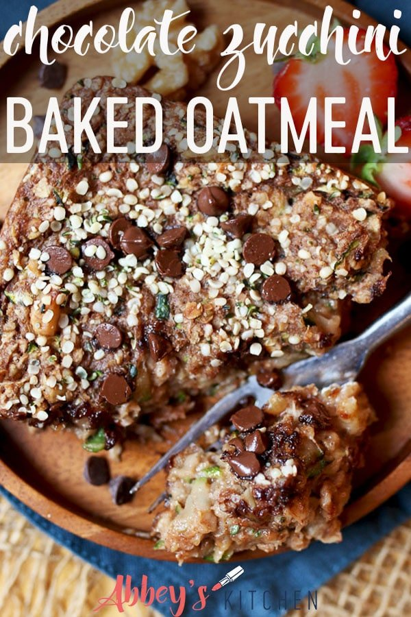 Pinterest image of vegetable and chocolate baked oatmeal on a wooden plate garnished with hemp seeds and chocolate chips with text overlay