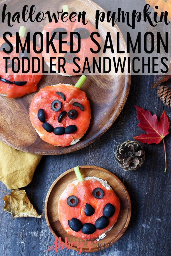Pinterest image of halloween themed sandwiches on wooden plates with text overlay