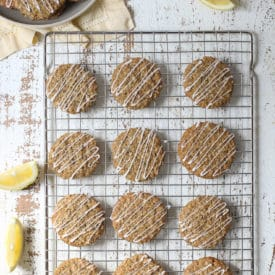 Lemon poppyseed cookies on a cooling rack.