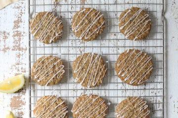 Lemon poppyseed cookies on a cooling rack.