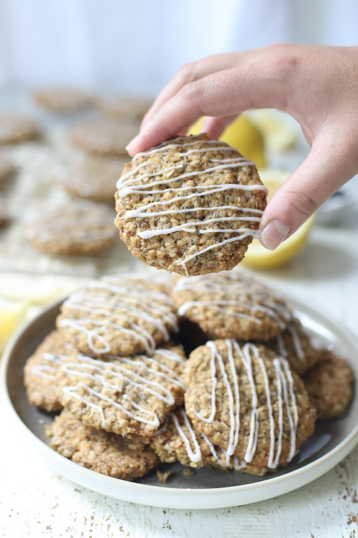 Hand holding a lemon poppyseed cookies.