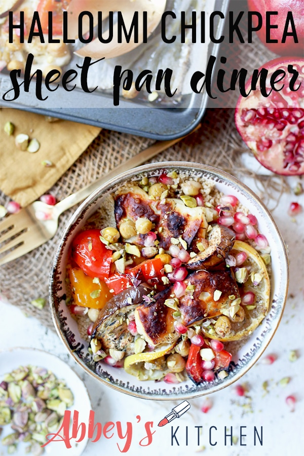 pinterest image of halloumi and chickpea sheet pan meal in a bowl garnished with pomegranate seeds with text overlay