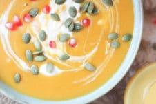 Orange soup in a bowl.